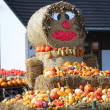 Fun autumn produce display on hay bales - Stock Photo
