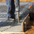 Stock Photo: Builder pouring concrete foundations