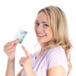 Happy woman pointing on credit card — Stock Photo #13640622