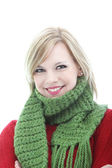 Smiling young woman in a winter scarf — Stock Photo