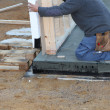 Builder installing a prefabricated wall — Foto Stock