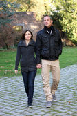 Young couple approaching walking hand in hand Young couple approaching walking hand in hand — Stock Photo