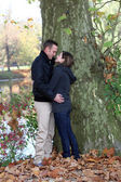 Passionate young couple on a lakeshore — Stock Photo