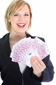 Smiling Blonde Woman Holding 500 Euro Notes — Stock Photo