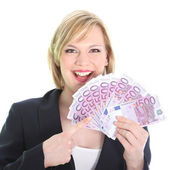 Gleeful woman pointing to bunch of 500 euro notes — Stock Photo