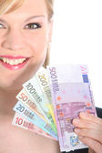 Friendly Blonde Woman Holding Euro Notes — Stock Photo