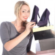 Blonde Woman Holding Boxes of Shoes — Stock Photo #14718295