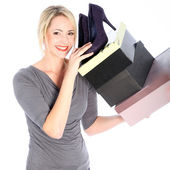 Blonde Woman Holding Boxes of Shoes — Stock Photo