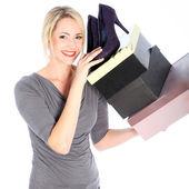 Donna bionda con scatole di scarpe — Foto Stock