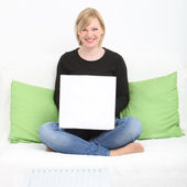 Relaxed woman using her laptop at home Relaxed woman using her laptop at home — Stock Photo