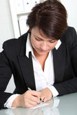 Businesswoman working at desk Businesswoman working at desk — Stock Photo