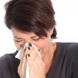 Woman suffering from a cold or flu Woman suffering from seasonal flu — Stock Photo #15563411