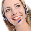 Smiling receptionist wearing a headset — Stock Photo #15759861
