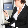 Businesswoman pulling a face at a text message Business woman making a face — Stock Photo