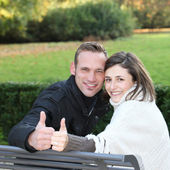 Happy young couple giving a thumbs up Happy young couple giving a thumbs up — ストック写真