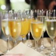 Flutes of chilled white champagne — Stock Photo