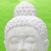 Skär av huvudet av en yoga som mediterar staty — Stockfoto