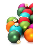 Colourful Christmas baubles over white — Stock Photo