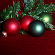 Red and green baubles — Stock Photo
