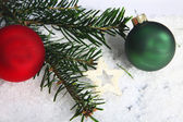 Pine needles and baubles — Stock Photo