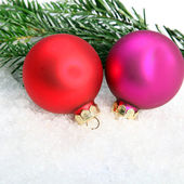 Two colorful Christmas baubles — Stock Photo