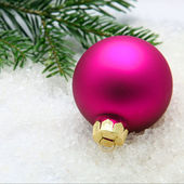 Fuchsia colored Christmas bauble — Stok fotoğraf