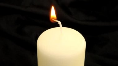 Lighting a candle with a match — Vídeo de stock