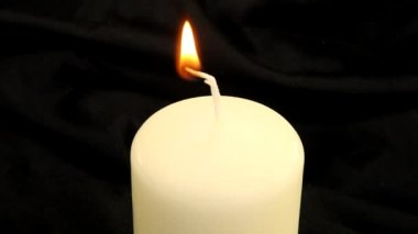 Lighting a candle with a match — Wideo stockowe