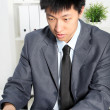 Professional Asian man focusing at his desk — Foto Stock