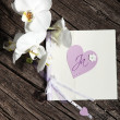 Pretty Valentine card with heart and flowers - Stock Photo