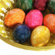 Colourful painted Easter Eggs in a basket — Stock Photo