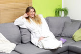 Woman in bathrobe — Stockfoto