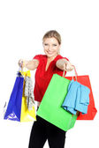 Happy woman shopping for clothing — Stock Photo