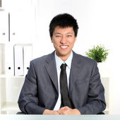 Confident happy young Asian businessman — Stock Photo