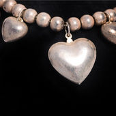 Necklace with a silver heart — Stock Photo