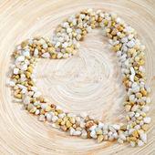 Pebble heart on earthenware — Stock Photo