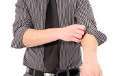 Man rolling up his shirt sleeves — Stock Photo