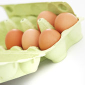 Fresh eggs in a cardboard carton — Stock Photo