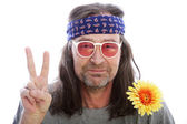 Male hippie making a peace sign — Стоковое фото