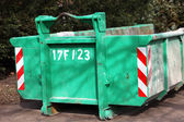 Green colored heavy dumper — Stock Photo