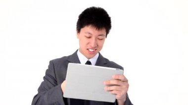 Asian young businessman using a tablet — Stock Video