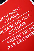 """Do not disturb!"" sign in different languages — Stock Photo"