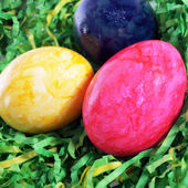 Easter painted eggs in artificial grass — Stok fotoğraf