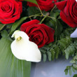 Arum lily in a bridal bouquet of red roses — Stok fotoğraf