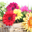 Bright summer flowers in a basket — Stock Photo