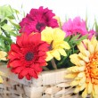 Bright summer flowers in a basket — Stock Photo #24353939