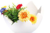 Large egg decorated with flowers — Stock Photo