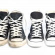 Stock Photo: Two pairs of sneakers - one old, one new