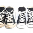 Two pairs of sneakers - one old, one new — Stock Photo #24375179