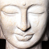 Serene face of a stone Buddha — Stock Photo